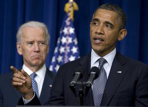"photo - FILE - In this Jan. 16, 2013 file photo, President Barack Obama, accompanied by Vice President Joe Biden, talks about proposals to reduce gun violence, in the South Court Auditorium at the White House in Washington. This is what ""Forward"" looks like. Fast forward, even. President Barack Obama's campaign slogan is springing to life in a surge of executive directives and agency rulemaking touching many of the affairs of government. They are shaping the cost and quality of health plans, the contents of the school cafeteria, the front lines of future combat, the price of coal. They are the leading edge of Obama's ambition to take on climate change in ways that may be unachievable in legislation.  (AP Photo/Carolyn Kaster, File)"