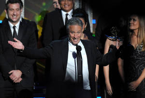 "Photo -   Jon Stewart accepts the award for Outstanding Variety Series for ""The Daily Show with Jon Stewart"" at the 64th Primetime Emmy Awards at the Nokia Theatre on Sunday, Sept. 23, 2012, in Los Angeles. (Photo by John Shearer/Invision/AP)"