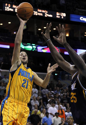 Photo -   New Orleans Hornets point guard Greivis Vasquez (21) scores the winning basket in the fourth quarter over Utah Jazz center Al Jefferson (25) during an NBA basketball game in New Orleans, Friday, Nov. 2, 2012. The Hornet won 88-86. (AP Photo/Jonathan Bachman)