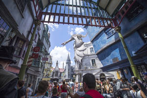 Photo - This image released by Universal Orlando shows guests at Diagon Alley at the Wizarding World of Harry Potter at Universal Orlando, in Orlando, Fla., on Wednesday, July 9, 2014. For a second day in a row, visitors waited up to five hours to get on the ride, Harry Potter and the Escape from Gringotts, located in the new Diagon Alley section of Universal Studios. On Tuesday, July 8, on the first day Diagon Alley was open to the public, visitors waited for as long as seven hours. (AP Photo/Universal Orlandi, Sheri Lowen)