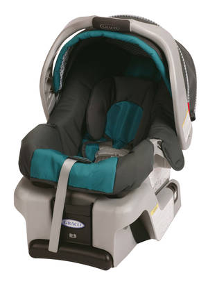 Photo - This undated photo provided by Graco Children's Products shows a SnugRide Classic Connect infant car seat. Graco Children's Products is recalling 1.9 million infant car seats, bowing to demands from U.S. safety regulators in what is now the largest seat recall in American history. Buckles can get gummed up by food and drinks, and that could make it hard to remove children. Infant-seat models covered by the recall issued Tuesday, July 1, 2014, include the SnugRide, SnugRide Classic Connect (including Classic Connect 30 and 35), SnugRide 30, SnugRide 35, SnugRide Click Connect 40, and Aprica A30. They were manufactured between July 2010 and May 2013, according to the National Highway Traffic Safety Administration. (AP Photo/Graco Children's Products)