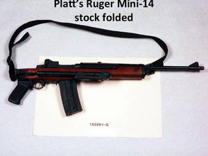Photo - This undated evidence photo, provided by retired FBI agent Edmund Mireles, shows the Ruger Mini–14 used by one of the shooters in the deadly April 11, 1986 bank robbery shootout in Miami that left two FBI agents dead and five others injured. New models of this firearm that have folding stocks and pistol grips would be banned under proposed gun control legislation under consideration in Congress. But a similar model without a folding stock would be exempted. Both models can take detachable magazines that hold dozens of rounds of ammunition. Mireles was among the five agents injured. (AP Photo/FBI)