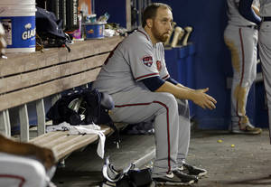 Photo - Atlanta Braves starting pitcher Aaron Harang sits in the dugout during the fourth inning of a baseball game against the Miami Marlins, Wednesday, April 30, 2014, in Miami. (AP Photo)
