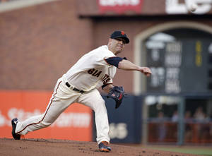 Photo - San Francisco Giants starting pitcher Tim Hudson throw against the San Diego Padres in the first inning of a baseball game Wednesday, April 30, 2014, in San Francisco. (AP Photo)