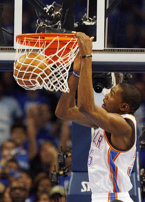 Photo - Oklahoma City's Kevin Durant (35) dunks the ball during Game 3 of the Western Conference Finals between the Oklahoma City Thunder and the San Antonio Spurs in the NBA playoffs at the Chesapeake Energy Arena in Oklahoma City, Thursday, May 31, 2012.  Photo by Nate Billings, The Oklahoman