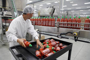 Photo - FILE - In this Oct 29, 2013 file photo, Sriracha chili sauce is produced at the Huy Fong Foods factory in Irwindale, Calif. The Commerce Department reports on wholesale prices for November on Friday, Dec. 13, 2013. (AP Photo/Nick Ut, File)