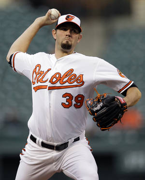 photo -   Baltimore Orioles starting pitcher Jason Hammel throws to the Toronto Blue Jays in the first inning of a baseball game in Baltimore, Wednesday, April 25, 2012. (AP Photo/Patrick Semansky)