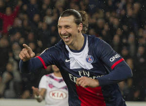 Photo - Paris Saint Germain's Zlatan Ibrahimovic, right, of Sweden celebrates after scoring against Bordeaux during their French League One soccer match, Friday Jan. 31, 2014, at Parc des Princes stadium, in Paris, France. (AP Photo/Jacques Brinon)
