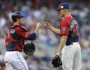 Photo - U.S. catcher Justin O'Conner, left, celebrates with pitcher Noah Syndergaard after the team's 3-2 victory over the World team in the All-Star Futures baseball game, Sunday, July 13, 2014, in Minneapolis. (AP Photo/Jeff Roberson)