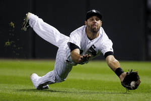 Photo - Chicago White Sox right fielder Jordan Danks catches a fly ball hit by Minnesota Twins' Plouffe during the fifth inning of a baseball game Tuesday, Sept. 17, 2013, in Chicago. (AP Photo/Andrew A. Nelles)