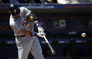 Photo - Detroit Tigers' Miguel Cabrera hits a home run in the third inning of an exhibition spring training baseball game against the New York Mets, Tuesday, March 18, 2014, in Port St. Lucie, Fla. (AP Photo/David Goldman)