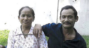Photo - This undated photo provided by the Philadelphia District Attorney's Office shows Karnamaya Mongar and her husband. Karnamaya Mongar died after being given too much anesthesia and pain medication during a 2009 abortion. The only licensed doctor on staff at the clinic where Mongar died, goes on trial Monday, March 18, 2013, on eight counts of murder, but prosecutors say he's not the only person to blame for the deaths. (AP Photo/Philadelphia District Attorney)