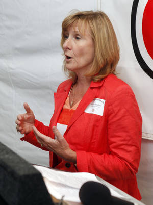 Photo - Phillips 66 Transportation President Debbie Adams speaks Tuesday as the company celebrates a safety program achievement with OSHA at their      facility on NE 10 in Oklahoma City.  Photo by Paul Hellstern, The Oklahoman <strong>PAUL HELLSTERN</strong>