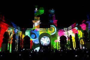 Photo - An image of Brazuca, the 2014 World Cup official soccer ball, is projected during a 3D presentation at its unveiling in Rio de Janeiro, Brazil, Tuesday, Dec. 3, 2013. (AP Photo/Victor R. Caivano)
