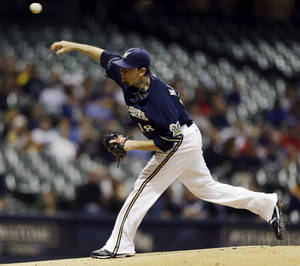 Photo -   Milwaukee Brewers starting pitcher Shaun Marcum throws to the San Diego Padres during the first inning of a baseball game, Monday, Oct. 1, 2012, in Milwaukee. (AP Photo/Jeffrey Phelps)