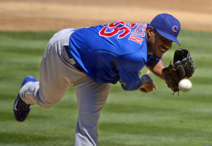 Photo - Chicago Cubs starting pitcher Edwin Jackson throws to the plate during the second inning of a baseball game against the Los Angeles Dodgers, Wednesday, Aug. 28, 2013, in Los Angeles.  (AP Photo/Mark J. Terrill)