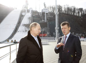 photo - Russian President Vladimir Putin, left,  speaks with  Deputy Prime Minister Dmitry Kozak,  who oversees Sochi preparations, as he visits a ski jumping complex in Krasnaya Polyana near the Black Sea resort of Sochi, southern Russia, Wednesday, Feb. 6, 2013. The Games will take place in a coastal cluster where indoors sports such as ice-hockey will be held and in a mountain complex where athletes will compete for medals in skiing and other outdoors disciplines. (AP Photo/Sergei Karpukhin, Pool)