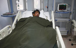 Photo - A Nepalese Sherpa Dawa Tashi, who was injured during an avalanche, gets treatment at a hospital in Katmandu, Nepal, Friday, April 18, 2014. An avalanche swept down a climbing route on Mount Everest early Friday, killing at least 12 Nepalese guides and leaving three missing in the deadliest disaster on the world's highest peak. (AP Photo/Niranjan Shrestha)