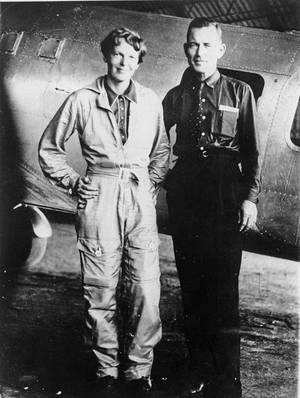 Photo - Famed aviator Amelia Earhart and her navigator, Fred Noonan, pose in front of their twin-engine Lockheed Electra in Los Angeles in May 1937, before their attempt to fly around the world. Technology might help reveal what happened to Earhart when she, Noonan and their Lockheed Electra plane disappeared nearly 70 years ago. AP FILE PHOTO