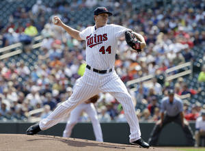 Photo - Minnesota Twins pitcher Kyle Gibson throws against the New York Mets in the first inning of a baseball game, Monday, Aug. 19, 2013 in Minneapolis. (AP Photo/Jim Mone)