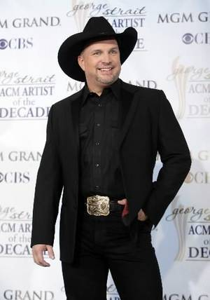 Photo - Garth Brooks poses backstage at the ACM Artist of the Decade All Star Concert in Las Vegas, Monday, April 6, 2009. AP Photo