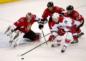 Photo - Carolina Hurricanes Alexander Semin tries to handle the puck past Ottawa Senators goalie Craig Anderson under pressure from Marc Methot (3) and Erik Condra (22) during second period NHL action Monday March 31, 2014 in Ottawa. (AP Photo/The Canadian Press, Adrian Wyld)