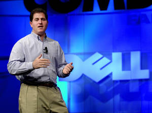 photo - FILE - In this  Monday, Nov. 13, 2000 photo, Michael Dell, Chairman and CEO of Dell, speaks during his keynote address at Comdex, in Las Vegas. Dell is trying to reassure shareholders about its proposed $24.4 billion acquisition by a group led by its founder, saying it considered a number of strategic options before agreeing to the deal and felt the bid is in the best interest of stockholders. (AP Photo/Mark J. Terrill, FIle)