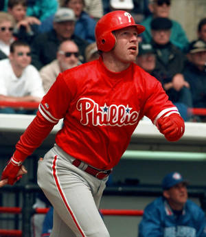 photo - FILE - In this March 10, 1998, file photo, Philadelphia Phillies' Lenny Dykstra watches the flight of his triple in the third inning of a spring training baseball game against the Toronto Blue Jays in Dunedin, Fla. Dykstra was sentenced Monday, Dec. 3, 2012, to 6½ months in prison for hiding baseball gloves and other heirlooms from his playing days that were supposed to be part of his bankruptcy filing, capping a tumultuous year of legal woes. (AP Photo/Pat Sullivan, File)
