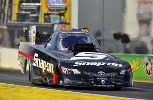 Photo - In this photo submitted by the NHRA, Cruz Pedregon races to the No. 1 qualifying position in Funny Car at the Amalie Motor Oil NHRA Gatornationals drag races, Saturday, March 15, 2014, in Gainesville, Fla. (AP Photo/NHRA, Teresa Long)
