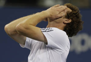 Photo -   Britain's Andy Murray reacts after beating Serbia's Novak Djokovic in the championship match at the 2012 US Open tennis tournament, Monday, Sept. 10, 2012, in New York. (AP Photo/Charles Krupa)