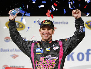 photo -   Clint Bowyer celebrates in victory lane after winning the NASCAR Bank of America 500 Sprint Cup series auto race in Concord, N.C., Saturday, Oct. 13, 2012. (AP Photo/Chuck Burton)