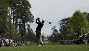 Photo - Adam Scott, of Australia, tees off on the seventh hole during a practice round for the Masters golf tournament Tuesday, April 8, 2014, in Augusta, Ga. (AP Photo/Charlie Riedel)