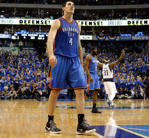 photo - Oklahoma City's Nick Collison (4) walks back to the bench during game 1 of the Western Conference Finals in the NBA basketball playoffs between the Dallas Mavericks and the Oklahoma City Thunder at American Airlines Center in Dallas, Tuesday, May 17, 2011. Photo by Bryan Terry, The Oklahoman ORG XMIT: KOD