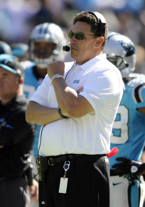 Photo - Carolina Panthers head coach Ron Rivera stand on the sideline during the first half of an NFL football game against the St. Louis Rams in Charlotte, N.C., Sunday, Oct. 20, 2013. (AP Photo/Mike McCarn)