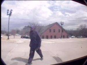 Photo -  A security camera shows a male suspect Friday entering the IBC Bank in Edmond. Photo provided  <strong></strong>