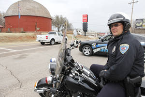 photo - Edmond police officer Tim Ivy watches passing drivers.  By Paul Hellstern, The Oklahoman Archives
