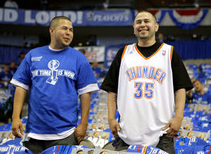 photo - Twins Jose, left, and Ruben Campos of Fort Worth Texas talk before game 1 of the Western Conference Finals in the NBA basketball playoffs between the Dallas Mavericks and the Oklahoma City Thunder at American Airlines Center in Dallas, Tuesday, May 17, 2011. Photo by Bryan Terry, The Oklahoman ORG XMIT: KOD