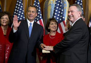 Photo - FILE - In this Jan. 3, 2013, file photo, Rep. Steve Stockman, R-Texas, right, participates in a mock swearing-in ceremony with Speaker of the House Rep. John Boehner, R-Ohio, for the 113th Congress in Washington. Stockman says he's back from a 10-day official visit to Egypt, Israel and Russia _ and is bristling at the notion he was ever missing.  (AP Photo/ Evan Vucci, File)