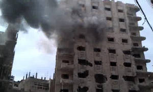"Photo -   This image made from amateur video and released by Bambuser Saturday, April 14, 2012 purports to show smoke from shelling in Homs, Syria. (AP Photo/Bambuser via AP video) THE ASSOCIATED PRESS CANNOT INDEPENDENTLY VERIFY THE CONTENT, DATE, LOCATION OR AUTHENTICITY OF THIS MATERIAL. TV OUT- MANDATORY CREDIT: ""BAMBUSER"""