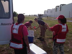 Photo - American Red Cross volunteers serve food and drinks to first responders Friday at Republic Paperboard Co., the site of a fire that burned for hours. <strong> - American Red Cross</strong>