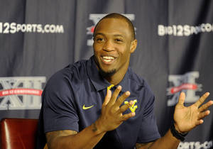 Photo - West Virginia wide receiver Tavon Austin gestures at NCAA college football Big 12 Media Days, Tuesday, July 24, 2012, in Dallas. (AP Photo/Matt Strasen)