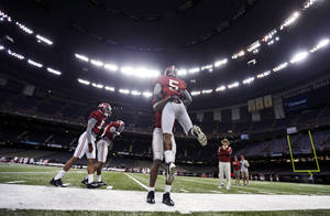 Photo - Alabama head coach Nick Saban, right, watches drillsduring NCAA college football practice at the Superdome in New Orleans, Saturday, Dec. 28, 2013.  Alabama takes on Oklahoma in the Sugar Bowl on Thursday, Jan. 2, 2013. (AP Photo/Gerald Herbert)