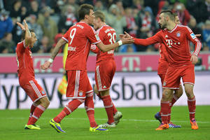 Photo - Munich's players celebrate after scoring during  the German first division Bundesliga soccer match between FC Bayern Munich and Hamburger SV  in Munich, Germany, Saturday, Dec. 14, 2013. (AP Photo/Kerstin Joensson)