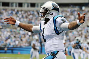 Photo -   Carolina Panthers quarterback Cam Newton (1) celebrates a teammate's touchdown during the third quarter of an NFL football game against the New Orleans Saints in Charlotte, N.C., Sunday, Sept. 16, 2012. (AP Photo/Rainier Ehrhardt)