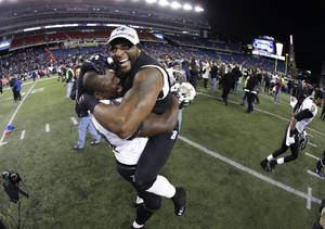 Photo - Baltimore Ravens inside linebacker Ray Lewis, right, celebrates with Vonta Leach after the NFL football AFC Championship football game against the New England Patriots in Foxborough, Mass., Sunday, Jan. 20, 2013. The Ravens defeated the Patriots 28-13 to advance to Super Bowl XLVII. (AP Photo/Matt Slocum)