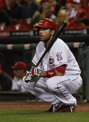 Photo - Cincinnati Reds Joey Votto gets ready to bat in the first inning of the baseball game between the Los Angeles Dodgers and the Cincinnati Reds in Cincinnati Tuesday June 10, 2014. (AP Photo/Tom Uhlman)