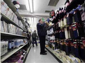 photo - In this Tuesday, Feb. 26, 2013 photo, Marty Grossman shops for a hat at Lodge's store on in Albany, N.Y. Americans spent at the fastest pace in five months in February, boosting retail spending 1.1 percent compared with January. About half the jump reflected higher gas prices, but even excluding gas purchases, retail sales rose 0.6 percent. The report Wednesday, March 13, 2013, from the Commerce Department showed that Americans kept spending last month despite higher Social Security taxes that took effect this year. (AP Photo/Mike Groll)