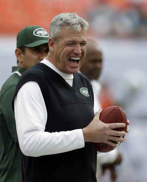 Photo - New York Jets head coach Rex Ryan has a laugh on the sideline before an NFL football game against the Miami Dolphins in Miami Gardens, Fla., Sunday, Dec. 29, 2013. (AP Photo/Alan Diaz)