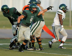 Photo - Edmond Santa Fe's Tyler Smith (4) reacts after Edmond Santa Fe recovered a fumble by Norman North's Nick Basquine (5) during a football scrimmage at Edmond Santa Fe High School in Edmond, Okla., Thursday, Aug. 22, 2013. Photo by Nate Billings, The Oklahoman
