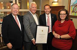 Photo - University of Oklahoma President David Boren with Apple Inc.'s Joel Davies, who is presenting a certificate to Dean Gregg Garn and Teresa Cullen, both from OU's Jeannine Rainbolt Education College.  Photo provided <strong> - PROVIDED</strong>